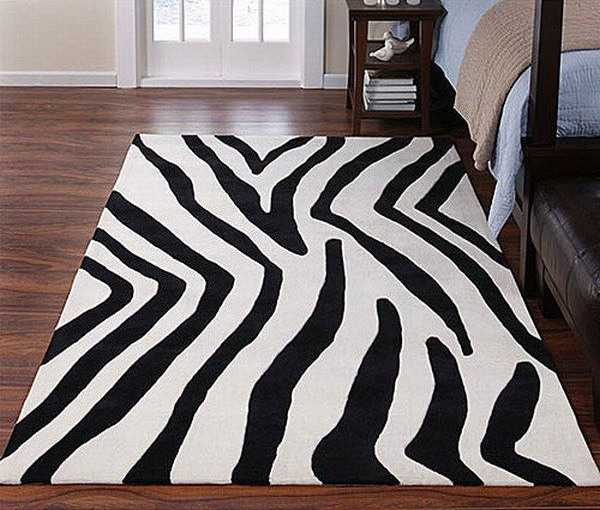 bedroom decorating in black and white with zebra floor rug