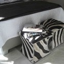 bedroom furniture, upholstered ottomans with zebra stripes