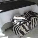 bedroom furniture, upholstered ottomans with zebra stripes