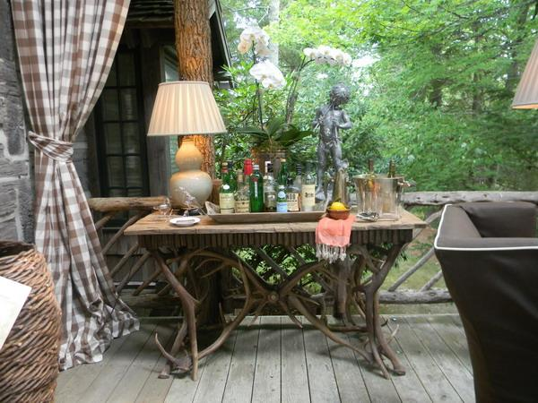 carved wood table for porch decorating