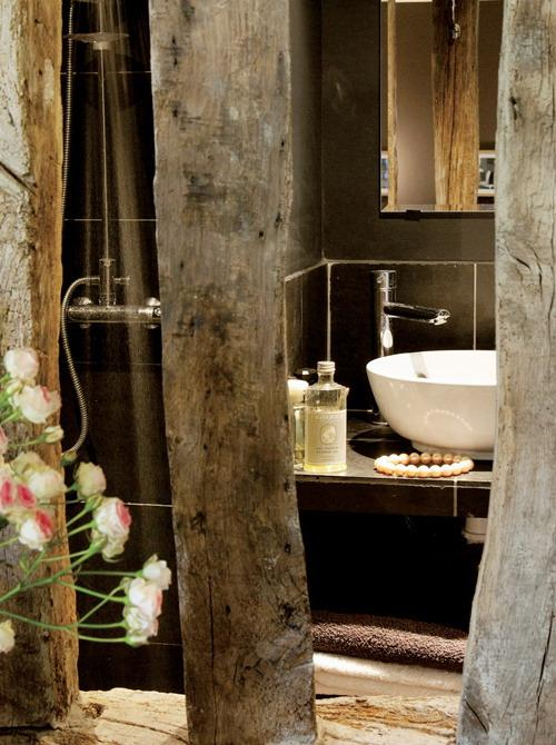 small bathroom design with antique wood posts