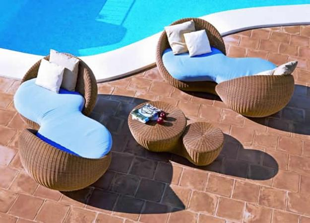pool patio with unique lounge chairs
