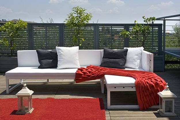 white and red outdoor sofa and ottomans