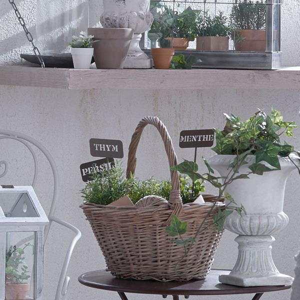 wicker baskets and white flowerpots with green plants green bedroom