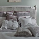 luxurious bedding set wih decorative pillows and lace