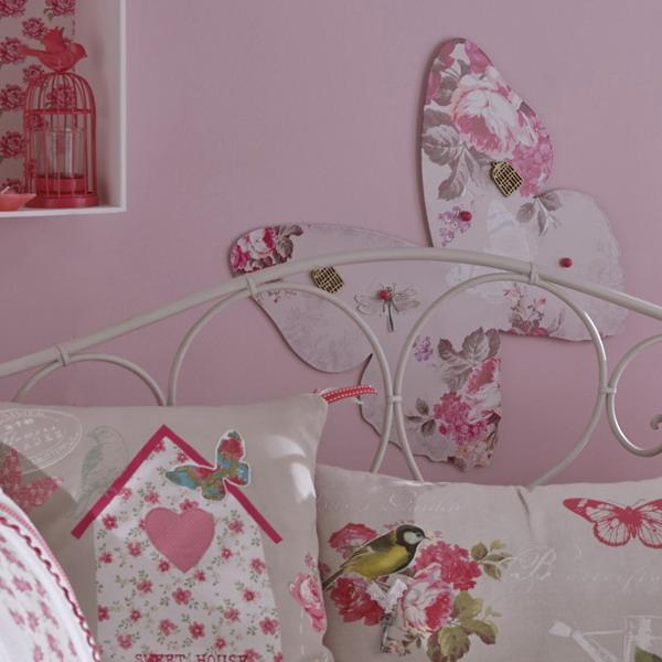 pink wall paint and white home fabrics with pink flowers, butterflies decorations for wall