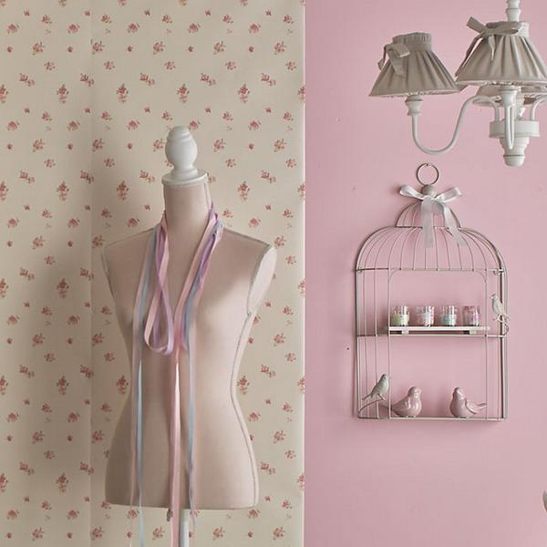 pink wall paint and cream colored wallpaper