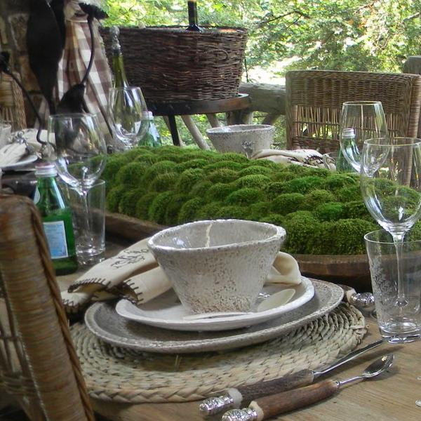 ceramic tableware and green moss centerpiece idea