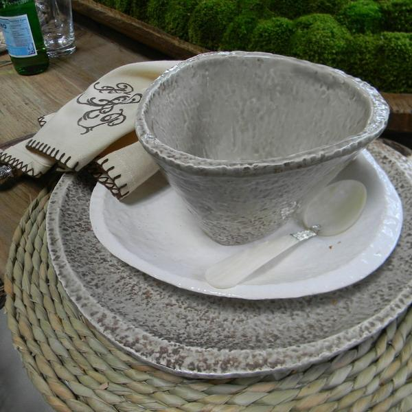 handmade ceramic tableware and rattan place mats