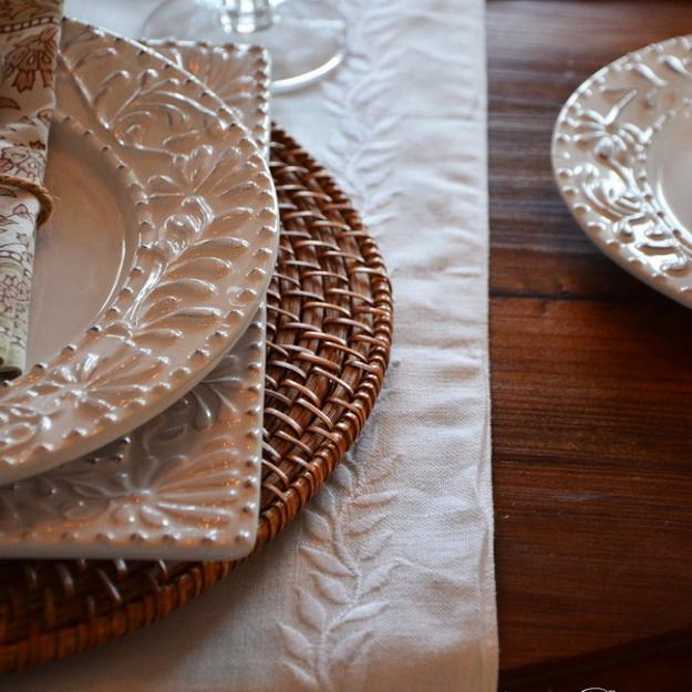 rattan placemat and white dishes