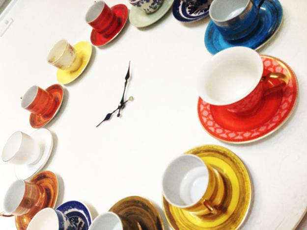 colorful wall clock made with tea cups and saucers