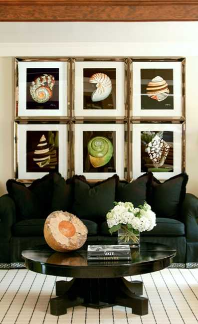 black sofa and wall decoration with art prints