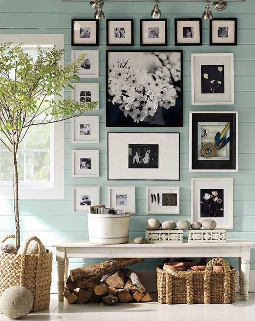 blue wall decoration with black and white photographs