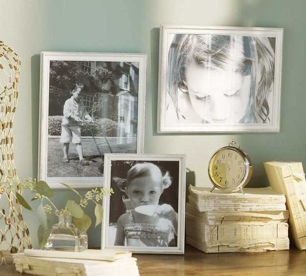 blue wall decoration with family pictures