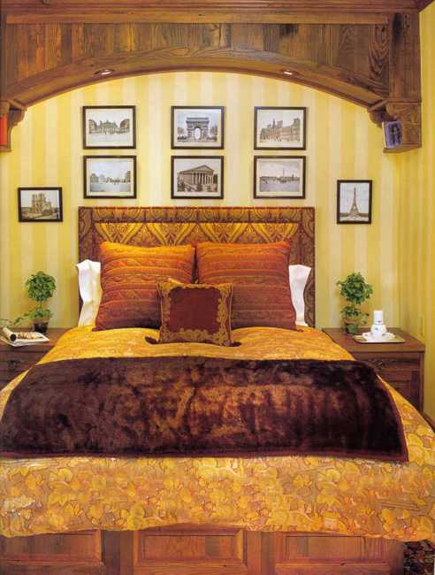 bedroom decorating with upholstered bed and wall pictures