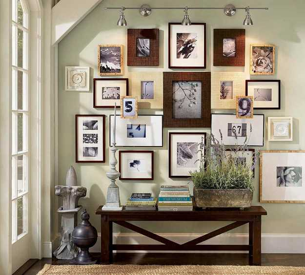 entryway wall decoration with art prints and photographs