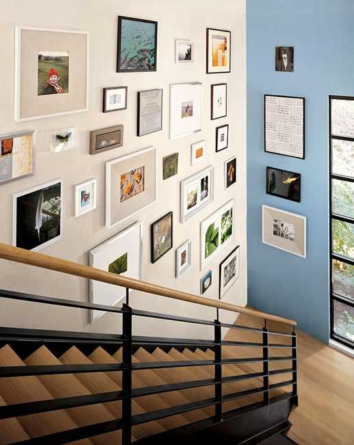 modern staircase design and wall decoration with art prints and pictures