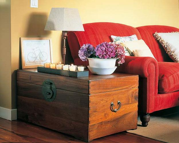 Wooden trunk used as side table for living room decorating 40 Ways to Enhance Room Decor with Chests and Trunks in Vintage Style