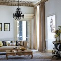 modern interior decorating in classic style. pastel room colors, vintage furniture, floral wallpaper patterns and home fabrics
