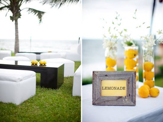 green colors of leaves and yellow color of lemons table centerpiece idea