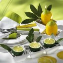 table decorations and centerpieces with lemons, yellow and green color combination