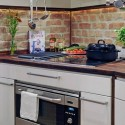 modern kitchen decor with brick accent wall