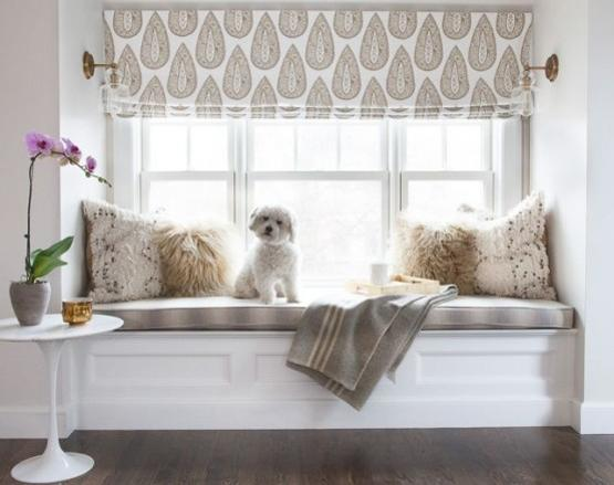 Window seat with cushions and roman shades in neutral colors