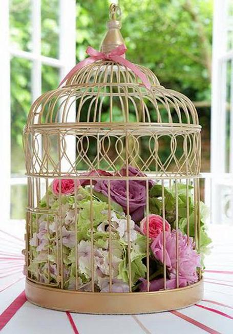 table decoration with flowers and birdcages